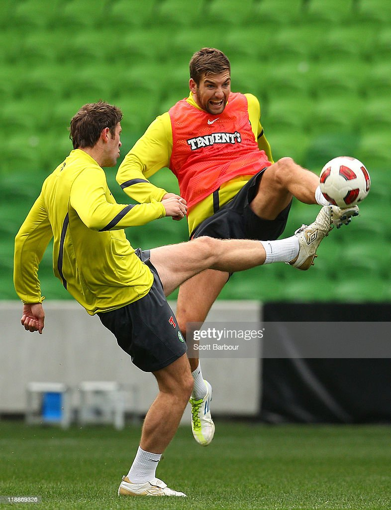 Charlie Mulgrew (R) of Celtic competes for the ball during a Glasgow Celtic training session at AAMI Park on July 12, 2011 in Melbourne, Australia.