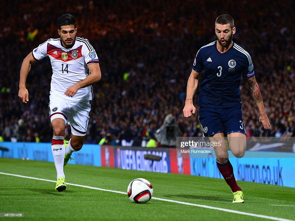 Charlie Mulgrew of Scotland challenges Emre Can of Germany during the EURO 2016 Qualifier between Scotland and Germany at Hamden Park on September 7, 2015 in Glasgow, Scotland.