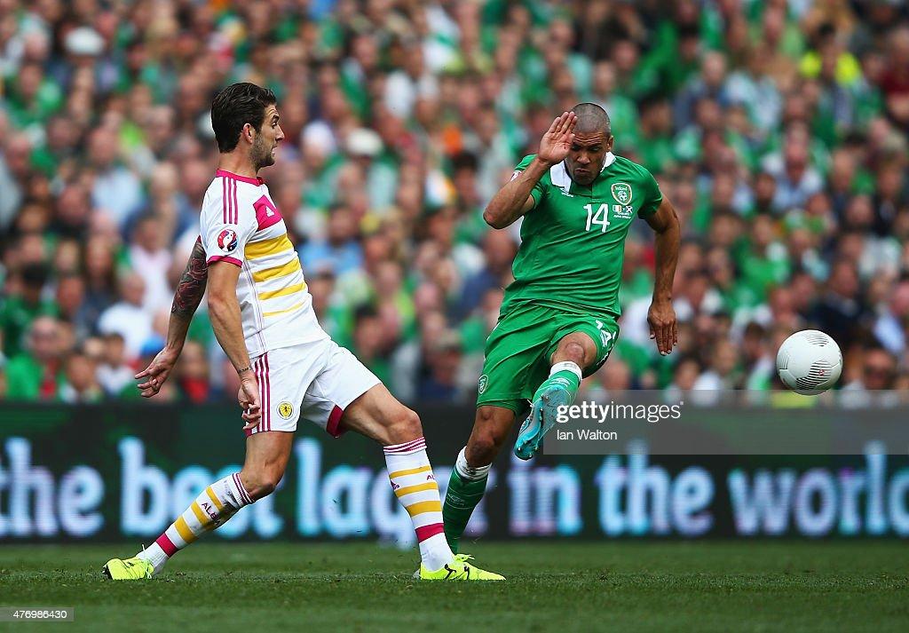 Charlie Mulgrew of Scotland challenges Jon Walters of Republic of Ireland during the UEFA EURO 2016 Qualifier Group D match between Republic of Ireland and Scotland at Aviva Stadium on June 13, 2015 in Dublin, Ireland.