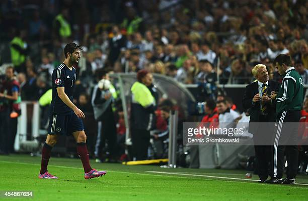 Charlie Mulgrew of Scotland is sent off as Gordon Strachan manager of Scotland talks to the fourth official during the EURO 2016 Group D qualifying...