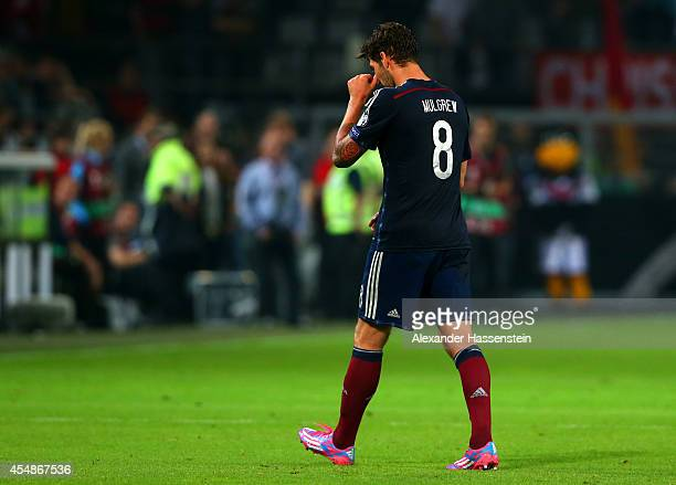 Charlie Mulgrew of Scotland is sent off during the EURO 2016 Group D qualifying match between Germany and Scotland at Signal Iduna Park on September...