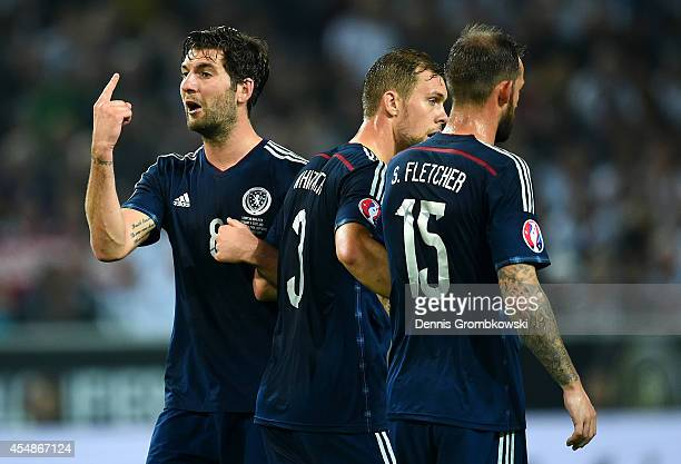 Charlie Mulgrew Steven Whittaker and Steven Fletcher of Scotland form a defensive wall during the EURO 2016 Group D qualifying match between Germany...