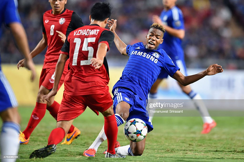 Charlie Musonda #44 of Chelsea FC and Chayawat Srinawong #15 of Thailand All-Stars competes for the ball during the international friendly match between Thailand All-Stars and Chelsea FC at Rajamangala Stadium on May 30, 2015 in Bangkok, Thailand.