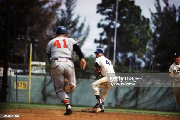 Charlie Neal of the Los Angeles Dodgers steps on second base as Eddie Mathews of the Milwaukee Braves is forced out during an MLB Spring Training...