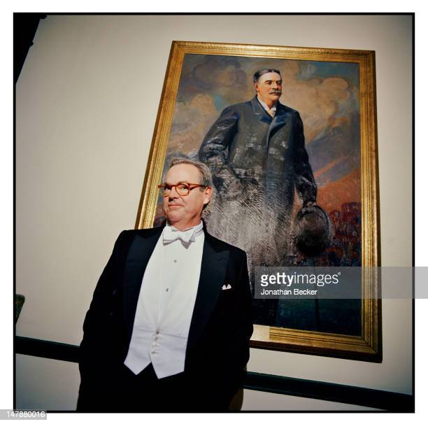 Charlie Neuhauser, chairman of the Tuxedo Club's House Committee, is photographed in front of a portrait of Tuxedo Park founder Pierre Lorillard IV...