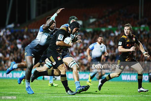 Charlie Ngatai of the Chiefs charges over to score his second try during the round five Super Rugby match between the Chiefs and the Western Force at...