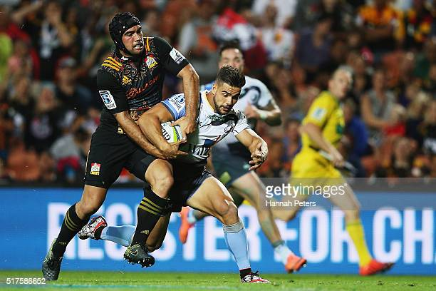 Charlie Ngatai of the Chiefs competes with Ryan Louwrens of the Force for the ball during the round five Super Rugby match between the Chiefs and the...