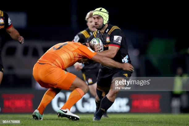 Charlie Ngatai of the Chiefs is tackled during the round 12 Super Rugby match between the Chiefs and the Jaguares at Rotorua International Stadium on...