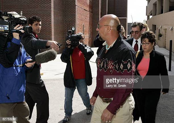Charlie Otero and his sister Carmen Montoya walk past the media outside the Sedgwick County Courthouse on the day of Dennis L Rader's second...