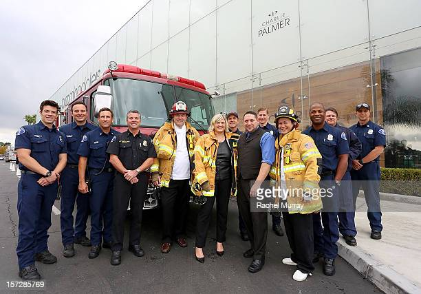 Charlie Palmer and members of the Costa Mesa fire department attend the Battle Of The Burgers with CMFA Charlie Palmer at Bloomingdale's South Coast...