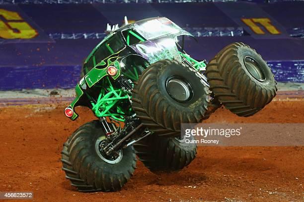 Charlie Pauken driving Grave Digger flips up on two wheels during Monster Jam at AAMI Park on October 4 2014 in Melbourne Australia