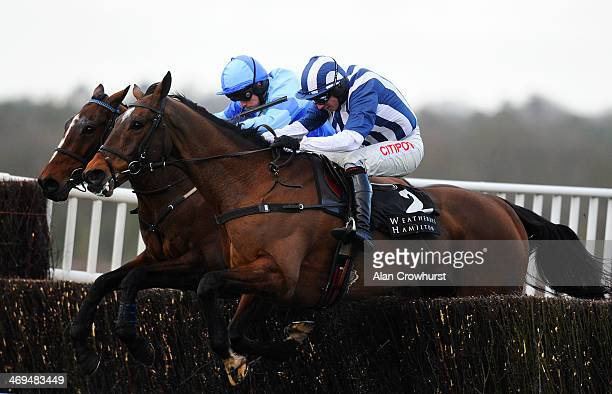 Charlie Poste riding Restless Harry clear the last to win The Weatherbys Hamilton Insurance Steeple Chase from Teaforthree at Ascot racecourse on...