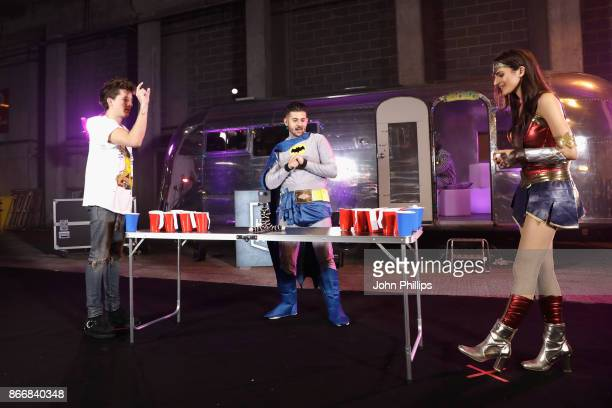 Charlie Puth Alex Mansuroglu and Andrea Zara play beer pong backstage at the Kiss Haunted House Party held at SSE Arena on October 26 2017 in London...