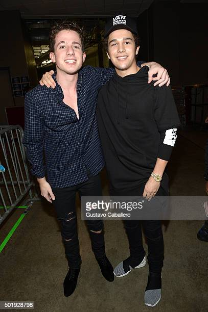 Charlie Puth and Austin Mahone pose backstage at Y100's Jingle Ball 2015 presented by Capital One at BBT Center on December 18 2015 in Sunrise Florida