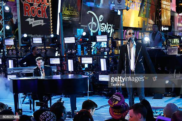 Charlie Puth and Wiz Khalifa perform 'See You Again' during Dick Clark's New Year's Rockin' Eve at Times Square on December 31 2015 in New York City