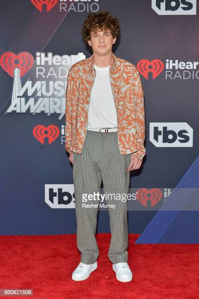Charlie Puth arrives at the 2018 iHeartRadio Music Awards which broadcasted live on TBS TNT and truTV at The Forum on March 11 2018 in Inglewood...