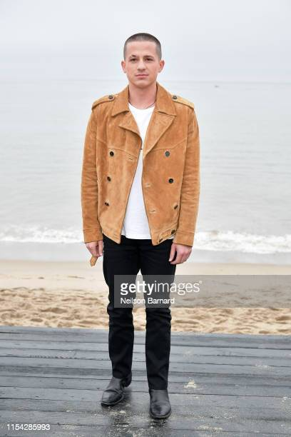 Charlie Puth attends the Saint Laurent Mens Spring Summer 20 Show on June 06 2019 in Paradise Cove Malibu California