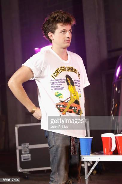 Charlie Puth plays beer pong backstage during the Kiss Haunted House Party held at SSE Arena on October 26 2017 in London England