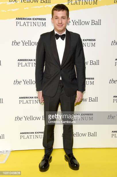 Charlie Puth poses on the Yellow carpet at the Yellow Ball hosted by American Express and Pharrell Williams at the Brooklyn Museum on September 10...
