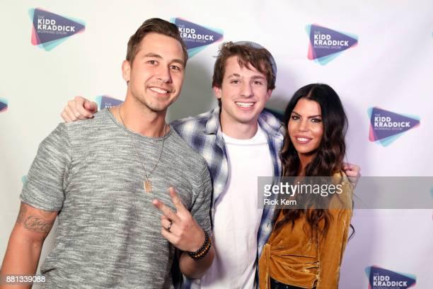 Charlie Puth poses with radio personalities Jose 'JSi' Chavez and Jenna Owens of The Kidd Kraddick Morning Show during 1061 KISS FM's Jingle Ball...