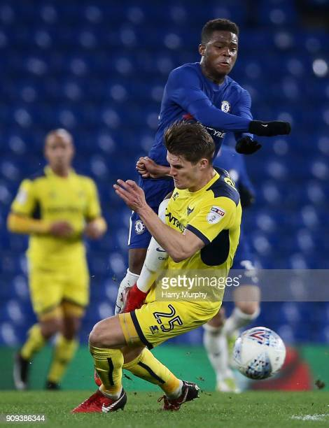 Charlie Raglan of Oxford United and Daishawn Redan of Chelsea clash during the Checkatrade Trophy match between Chelsea U21 and Oxford United at...