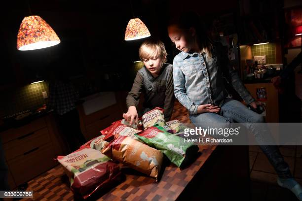 Charlie Reamer and his sister Olivia look at the assortment of new Jackson's Honest chips now available including Lime Sea Salt tortilla chips and...