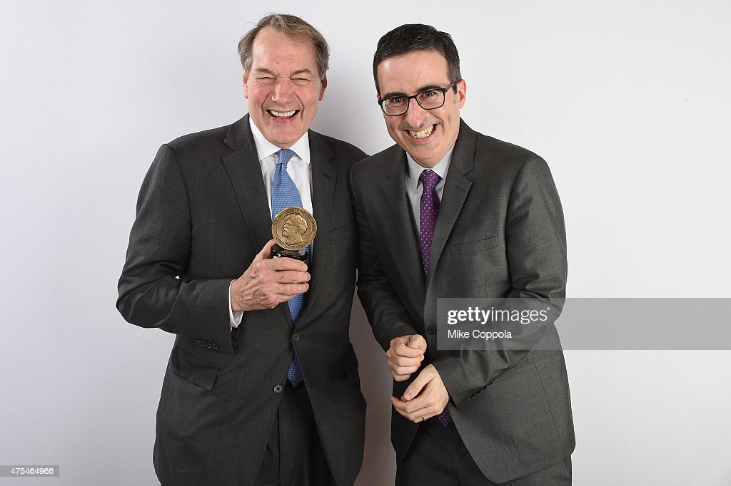 Charlie Rose and John Oliver pose with award during The 74th Annual Peabody Awards Ceremony at Cipriani Wall Street on May 31, 2015 in New York City.