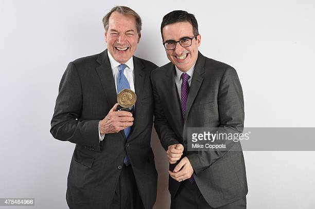 Charlie Rose and John Oliver pose with award during The 74th Annual Peabody Awards Ceremony at Cipriani Wall Street on May 31 2015 in New York City