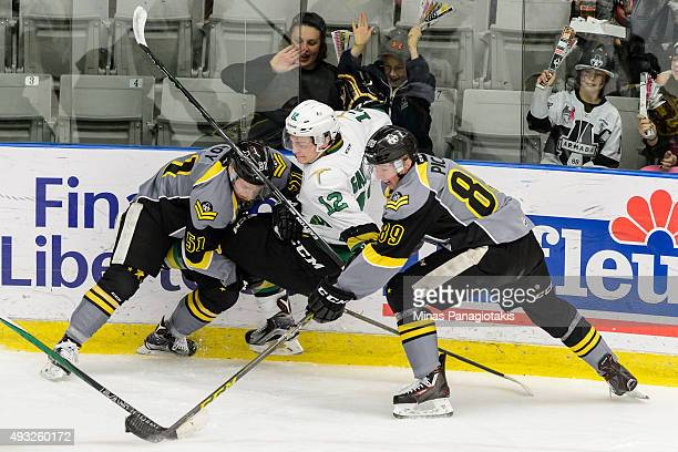 Charlie Roy of the BlainvilleBoisbriand Armada checks Julien Gauthier of the Vald'Or Foreurs near the boards during the QMJHL game at the Centre...
