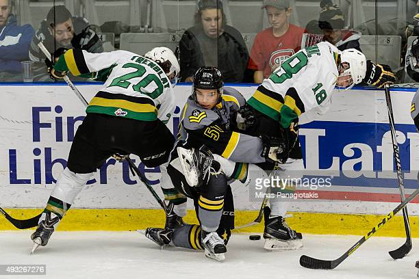 Charlie Roy of the BlainvilleBoisbriand Armada is caught in between Nathan Tremblay and William Gignac of the Vald'Or Foreurs during the QMJHL game...