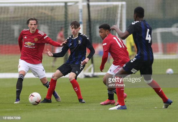 Charlie Savage and Dillon Hoogewerf of Manchester United U18s in action during the U18 Premier League match between Manchester United U18s and...