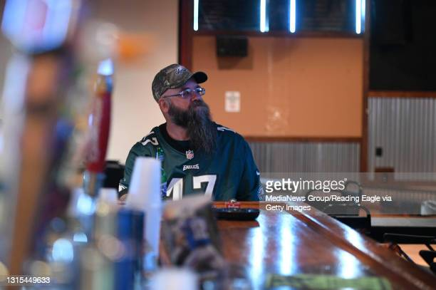 Charlie Secoges Jr. Of Reading takes in the game at Alley Oop's Sports Bar at Heister Lanes, one of a number of local bars that opened early to...