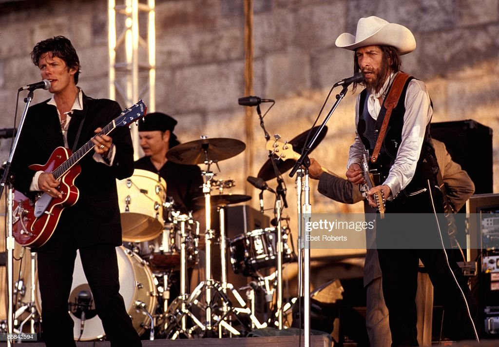 FESTIVAL Photo of Charlie SEXTON and Bob DYLAN, with Charlie Sexton, performing live onstage, with beard, wearing stetson