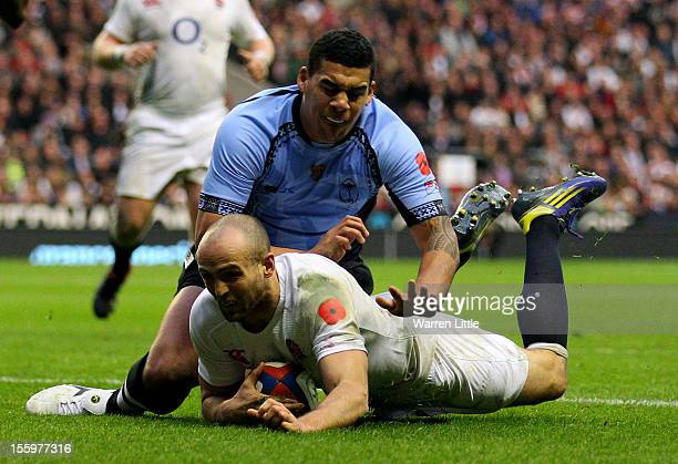 Charlie Sharples of England dives to score a try during the QBE international match between England and Fiji at Twickenham Stadium on November 10...