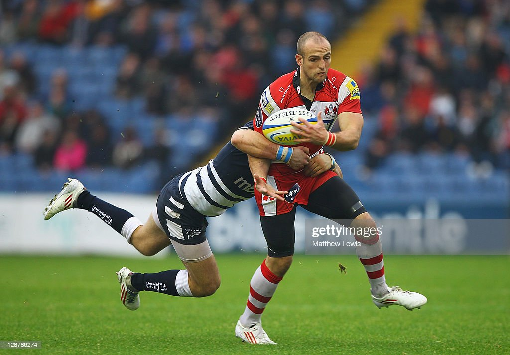 Charlie Sharples of Gloucester beats the tackle Will Addison of Sale during the AVIVA Premiership match between Sale Sharks and Gloucester at Edgeley Park on October 8, 2011 in Stockport, England.