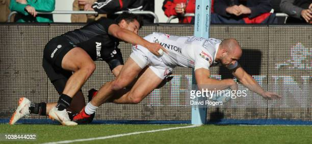 Charlie Sharples of Gloucester dives in to the corner for a try during the Gallagher Premiership Rugby match between Saracens and Gloucester Rugby at...
