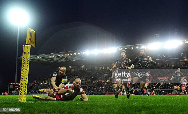 Charlie Sharples of Gloucester dives over for his side's first try under pressure from James Short of Exeter Chiefs during the Aviva Premiership...