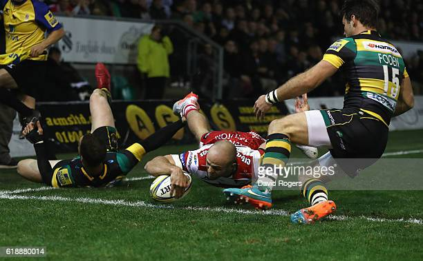 Charlie Sharples of Gloucester dives over for their second try during the Aviva Premiership match between Northampton Saints and Gloucester Rugby at...