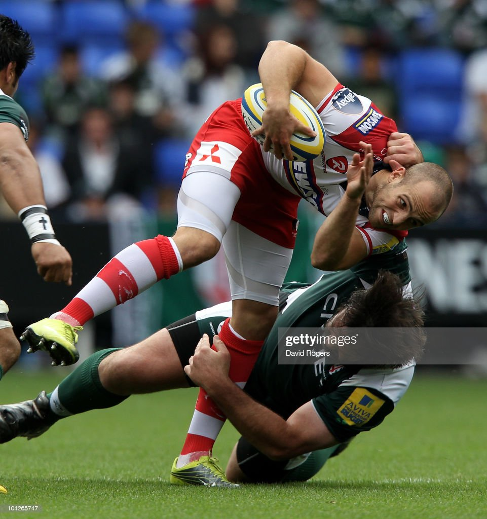 Charlie Sharples of Gloucester is tackled by Faan Rautenbach during the Aviva Premiership match between London Irish and Gloucester at the Madejski Stadium on September 19, 2010 in Reading, England.