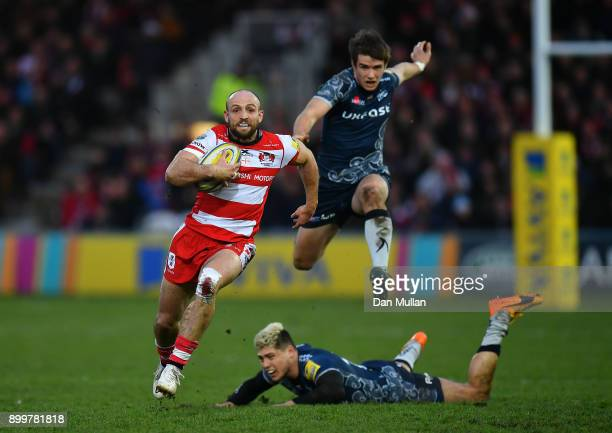 Charlie Sharples of Gloucester makes a break past James OConnor of Sale Sharks during the Aviva Premiership match between Gloucester Rugby and Sale...