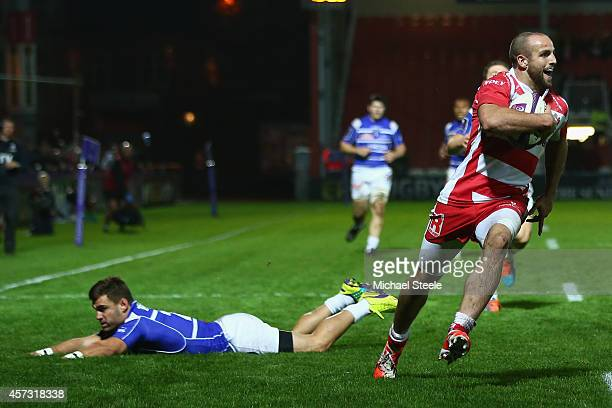 Charlie Sharples of Gloucester rounds Alfi Mafi of Brive to score his second try during the European Rugby Challenge Cup Pool 5 match between...