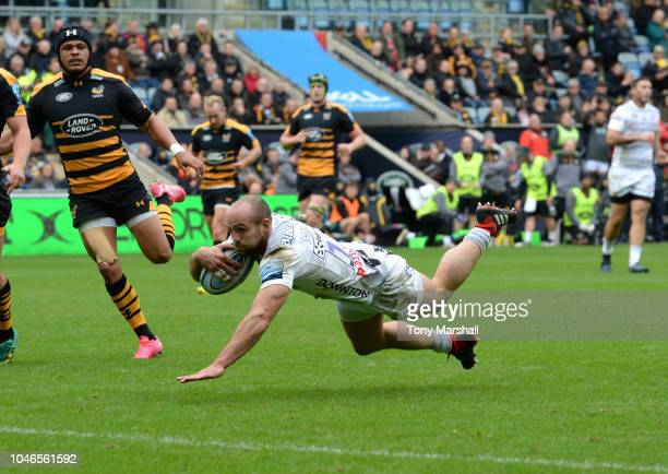 Charlie Sharples of Gloucester Rugby dives in to score their second try during the Gallagher Premiership Rugby match between Wasps and Gloucester...