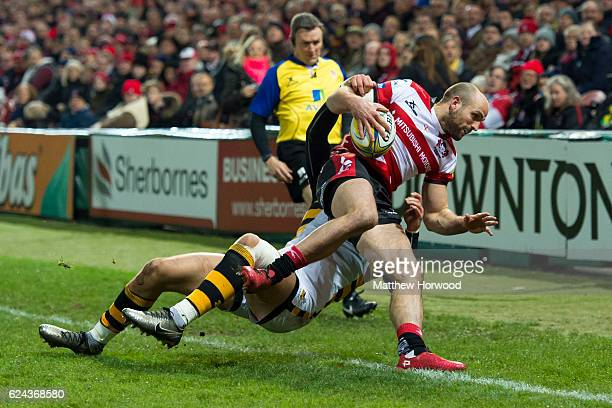 Charlie Sharples of Gloucester Rugby is tackled by Josh Bassett of Wasps during the Aviva Premiership match between Gloucester Rugby and Wasps at...