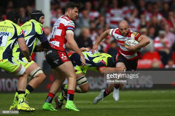 Charlie Sharples of Gloucester Rugby is tackled by Josh Beaumont of Sale Sharks during the Aviva Premiership match between Gloucester Rugby and Sale...