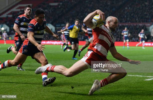 Charlie Sharples of Gloucester Rugby slips before getting up and going over for his sides first try during the Aviva Premiership match between...