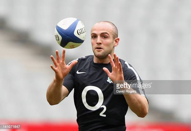 Charlie Sharples who will replace the injured David Strettle in the RBS Six Nations match against France catches the ball during the England...