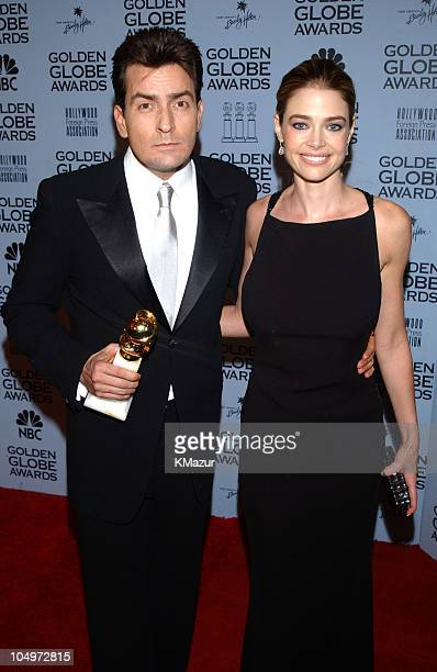 Charlie Sheen and fiancee Denise Richards with his award for Best Actor in a Television Musical/Comedy Series for his role in 'Spin City' at the 59th...