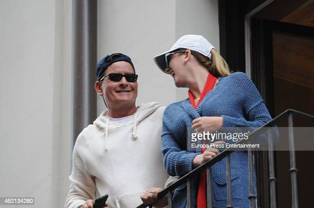 Charlie Sheen and Scottine Sheen watch the San Fermin Running Of The Bulls Festival on July 12 2014 in Pamplona Spain