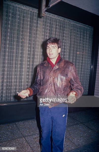 Charlie Sheen in a leather jacket and red scarf circa 1970 New York