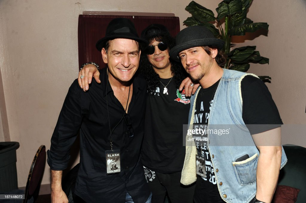 Charlie Sheen, Slash and Clifton Collins backstage at Slash featuring Myles Kennedy and the Conspirators at the Wiltern Theater on December 2, 2012 in Los Angeles, California.